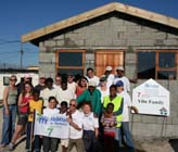 Habitat homeowners and their new home